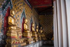 Row of Old Buddha gold and thai art architecture in Wat Arun buddhist temple in Bangkok, Thailand Royalty Free Stock Photo