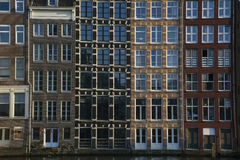 Row of old buildings in Amsterdam in the evening. In the dusk Royalty Free Stock Photography
