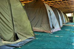 Row of old camping tents Royalty Free Stock Photography