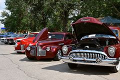 Row of old classic cars at a auto show. CASSELTON, NORTH DAKOTA, July 27, 2017: The annual Casselton Car Show which occurs the last Thursday of July features Royalty Free Stock Images