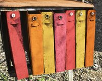 Vintage multicolor mail boxes outdoors. Row of old color rusty mail boxes for correspondence. Vintage style stock photography