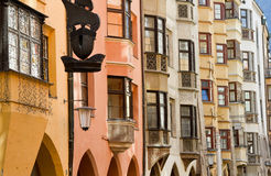 Row of old colorful buildings. Row of yellow, orange and white similar buildings in Innsbruck, Austria Stock Photography