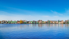 Row of old dutch traditional houses in Zaanse Schans and lake, Holland Stock Images