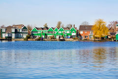 Row of old dutch traditional houses in Zaanse Schans and lake, Holland Stock Image