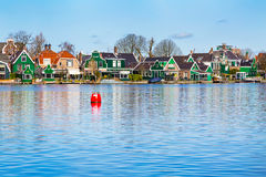 Row of old dutch traditional houses in Zaanse Schans and lake, Holland Royalty Free Stock Photography