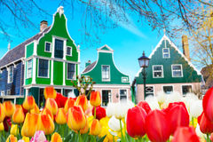 Row of old dutch traditional houses in Zaanse Schans and lake, Holland Royalty Free Stock Photo