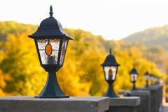 A row of old-fashioned streetlamps Stock Photo