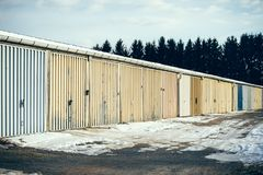 A row of old garages. In the winter stock photos