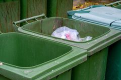 Row of old green trash bin in the community. Have a waste in the old green trash. Waste separation help reduce the amount of waste and recycle some types of Stock Image