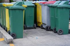 Row of old green and yellow and gray trash bin in the community,. Row of old green and yellow and gray trash bin in the community. Have a waste in the old green Royalty Free Stock Photography