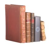 Row of old leather bound books and a hard drive Royalty Free Stock Images