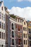 Row of old and modern canal houses in Amsterdam Royalty Free Stock Image