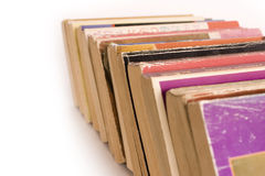 Row of Old Paperback Book. Row of colorful old paperback books on white background with space for copy Stock Photo