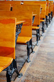 Row of old school desks Stock Photo