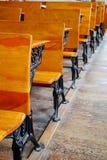 Row of old school desks Stock Photo