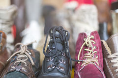 A row of old shoes on a flea market Stock Image