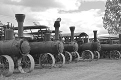 Row of old steam engines (black and white) Royalty Free Stock Photos
