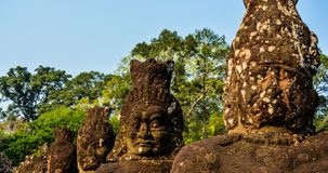 Old stone statues in Vietnam. Row of old stone statues in Vietnam, summer scene Royalty Free Stock Photos