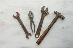 Row of old tools in wooden table stock photography