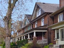 Row of old urban houses with gables. And large porches royalty free stock image
