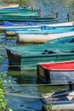 Row of old vintage colorful boats on the lake of Enghien les Bains near Paris France Stock Image