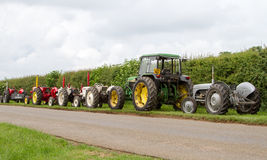 A row of old vintage tractors Royalty Free Stock Images