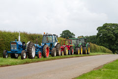 A row of old vintage tractors Royalty Free Stock Photos