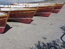 Row of old vintage wooden boats stand on dry dock for maintenance . Tuscany, Italy.  Royalty Free Stock Image