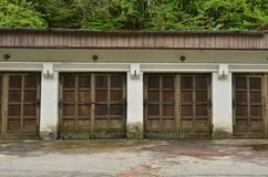 Row of old weathered wooden garage doors. A row of old weathered wooden garage doors royalty free stock images