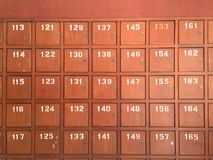 Row of old wooden post boxes in Thailand Stock Photo