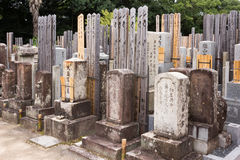 Row of older tomb stones at cemetery. Royalty Free Stock Images