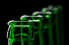 Row of open green beer bottles Royalty Free Stock Image