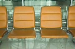 Row of orange chair Stock Photo