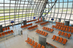Row of orange chair at airport. Royalty Free Stock Image