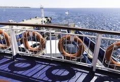 Row of orange lifeline in ferry Stock Photos