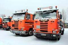 Row of Orange Scania Trucks Royalty Free Stock Photos