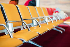 Row of orange seats with electric socket Stock Photos