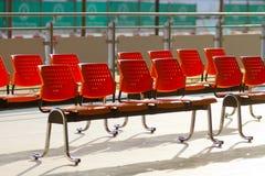 Row of orange seats. In Railway station Royalty Free Stock Photos