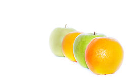 Row of oranges and green apples Stock Image