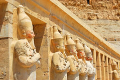 Row of Osiris statues at Hatshepsut temple. The Mortuary Temple of Queen Hatshepsut is situated beneath the cliffs at Deir el Bahari on the west bank of the Nile Royalty Free Stock Photo