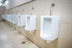 Row of outdoor urinals men public toilet Stock Images