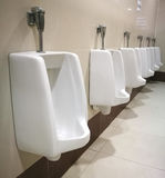 Row of outdoor urinals men public toilet,Closeup white urinals i Royalty Free Stock Image