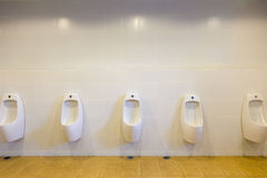 Row of outdoor urinals men public toilet,Closeup white urinals i Stock Image