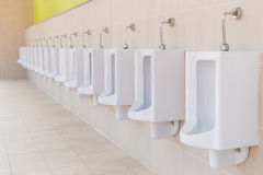 Row of outdoor urinals men public toilet Royalty Free Stock Photography