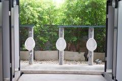Row of outdoor urinals men public toilet Royalty Free Stock Image