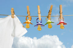 Row of pacifiers Stock Photos