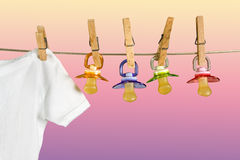 Row of pacifiers Royalty Free Stock Images