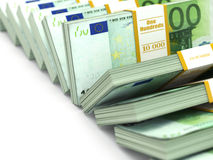 Row of packs of euro. Lots of cash money. Stock Photos