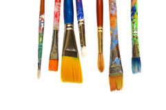 Row of Paint Brushes. Colorful paint brushes on a white background stock image