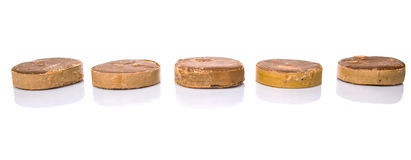 Row Of Palm Sugar. Row round palm sugar over white background royalty free stock photography